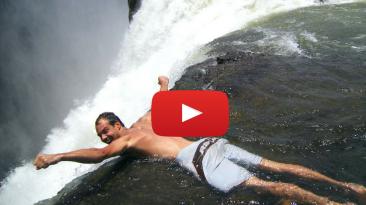 swim to the edge of waterfalls Zambia